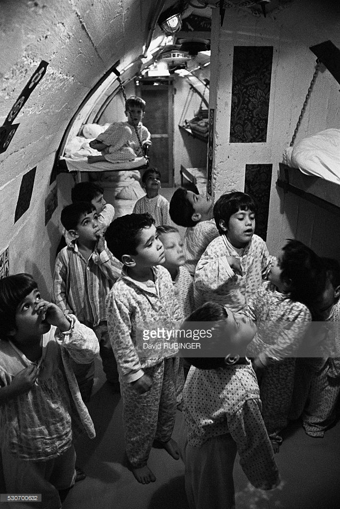 Children prepare to sleep underground at Kibbutz Maoz-Haim on the Jordanian border