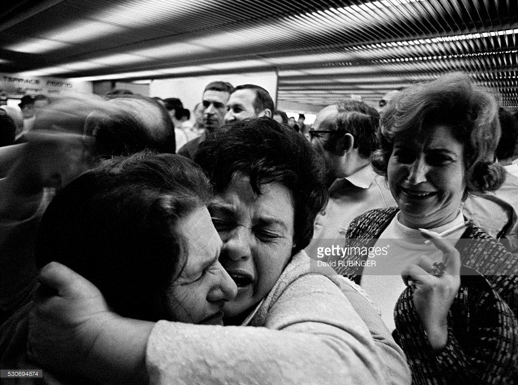 Two sisters - one living in Israel and one in the Soviet Union - meet after being separated for ages. Here at Ben-Gurion International airport they have their longed-for reunion.